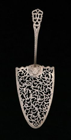 "1768 British Fish slice at the Museums Sheffield, Sheffield - From the curators' comments: ""This is a silver fish slice made in London in the late eighteenth century. It was intended for use in separating and serving portions of fish. Earlier designs were more triangular and pointed and were often used to drain and serve whitebait. This server would have been used to serve portions of a larger fish."""