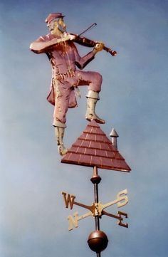 Fiddler on the Roof Weathervane by West Coast Weather Vanes. This copper made, unique handcrafted Fiddler on the Roof Weather Vane features glass eyes with Brass and Gold accents. Cultura Judaica, Blowin' In The Wind, Fiddler On The Roof, Lightning Rod, Weather Vanes, Les Themes, Jewish Art, Shop Signs, Wind Chimes