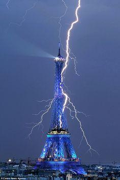 Incredible picture of lightning striking near the Eiffel Tower, July 2010.  Photo by Bertrand Kulik.