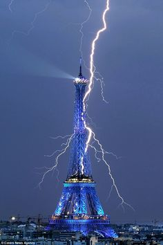 dramatic lightning strikes | ... Eiffel Tower glows blue as it is struck by the forked lightning bolt