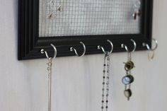 Black Framed Jewelry Organizer - DIY Savvy Home -- I have the framed earring thing - now I just need to put in the hooks!