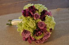 Vintage Style purple Bridesmaid Bouquet. - This smaller version of the Vintage Style Bridal Bouquet will coordinate your bridesmaids perfectly.  Constructed with green hydrangea, lavender spray roses and purple alstromeria, interspersed with dark green ruscus. Finished with your choice of satin or burlap and lace wrap and pins. - wedding bouquets