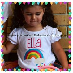Personalised Tutu's Amore Australialove our brand new baby girls rainbow tutu outfit inrainbow brightcolours.   Comprising of abright colouredrainbow in the colours of hot pink, aquablue, green, orange and yellow~it is set together perfectly with a tutu skirt in all the colours of the rainbow (well hot pink, aqua blue, yellow, green and purple) making it perfect for 1stfirst birthday rainbow theme parties or cake smash photographs along with