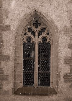 Gothic Architecture's Lancet Arch is a sharp pointed arch used in doors and windows outlining a triangle, 13th century. Photo: Bursin, Switzerland.