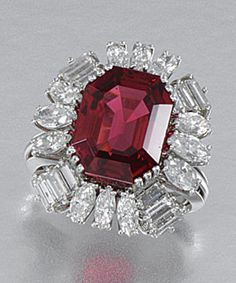 SPINEL AND DIAMOND RING, 1960S. Claw-set to the centre with an octagonal spinel weighing 8.24 carats within a surround set with marquise-shaped and baguette diamonds, size N, French assay and maker's marks.