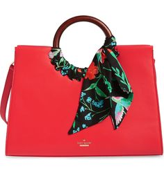 This classic leather tote with floral print silk ribbons combines modern edge with vintage vibes