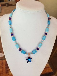 Beach inspired turquoise and blue czech glass with copper accents and swarovski starfish pendant necklace by RealBeadDesigns on Etsy