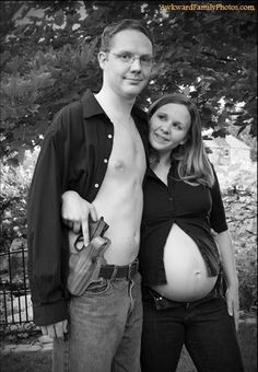 What makes people put guns and babies together in the same thought let alone a photo?