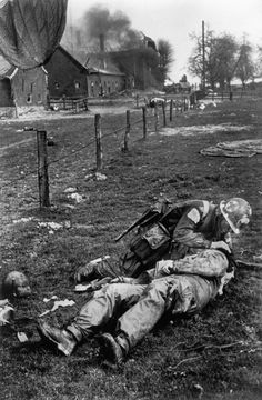 Wesel. March 24th, 1945. A wounded American paratrooper receiving aid from a medic//Robert Capa
