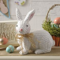 Greet your guests with the Easter spirit by placing this Faux Wicker Bunny Statue on your entryway console table! His raffia bow and cute pink nose will look adorable throughout the entire spring season, too!