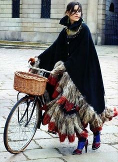 @Rachel R Lamb  Wow, now I just really want to go around wearing a feather cape while riding a bike in heels!