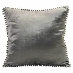 "Art silk pillow with pompom fringe.  Product: PillowConstruction Material: Art silk, cotton and polyesterColor: GreyFeatures:  Insert includedFringe edges Dimensions: 20"" x 20"""