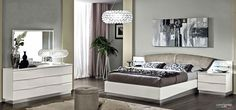 Contemporary white glossy bedroom set made in Italy. Wave shaped chromed handles character the distinctive design of the modern bedroom set in high gloss White. The set consists of Bed with upholstered headboard, 2 nightstands, double dresser and mirror. The bed has headboard with lights and glass s...