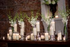 collected glass bottles plus candles make a nice look for a ceremony table