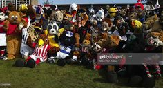 Football mascots from the UK wait to run in the fourth Mascot Grand National race at Huntingdon Racecourse, Huntingdon on September 29, 2002.