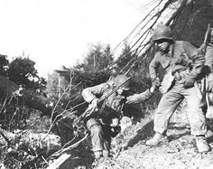 US soldiers struggling up a hill in the Hürtgen Forest, late 1944. (US Army Center of Military History)