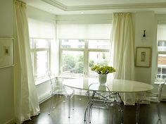 natural light, tray ceiling, ivory drapes, ghost chairs. check, check, check, check.