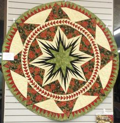 ~ Christmas Celebration Tree Skirt ~ Quiltworx.com....Carol Soehl, Quilted by Julie House....in Tucson, Arizona....