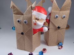 Origami Reindeer Container Christmas Decoration DIY. Reindeer-ing Around here... if you look at the reindeer on the right, you can see how the head slides over the body-portion.   The base is folded from a traditional origami offering table or spice holder