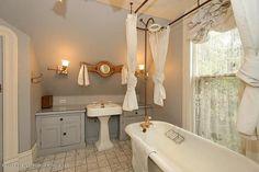 built in cabinets next to pedestal sink...