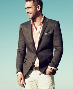 Khakis with pastel shirt and brown blazer. Simple, but classic.