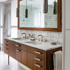 bathroom-mirror-and-pendant-lighting-with-mid-century-modern-bathroom-vanity-for-mid-century-modern-bathroom-also-marble-countertopt-with-subway-tile-backsplash-and-mid-century-modern-interiors