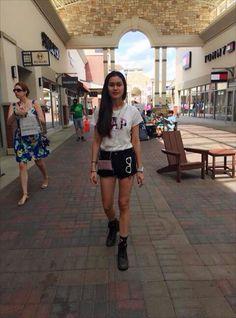 Pouch: Victoria secrets. Short: Run way dreams. Shirt: GAP. Shocks: Forever21. Shoes: Timberland. Sun glasses: Ray Ban.