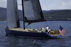SAIL Sizzler Coeur 60 Sailboat This incredible one-of-a-kind wood sailboat was designed specifically for Lake Coeur d'Alene and built by Hagadone Marine Group. The entire yacht is sailed single-handedly by her owner using an array of sophisticated hydraulic controls. She is 60 feet long with a 94-foot-tall mast, displaces 42,000 pounds, and has 30 coats …