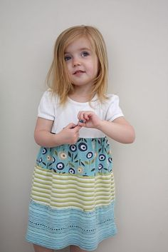T-shirts to dress: cute idea (This dress is made from 4 different T-shirts that were cut and sewed together.)