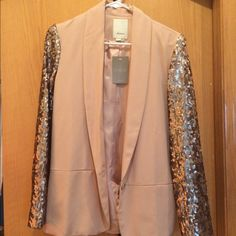 *HP* Anthropologie blazer Blush/champagne body and sequin sleeves Anthropologie blazer BNWT. Size 4. Slightly oversized style so a 4 could fit a 6 comfortably and it won't look bulky if you're a size down at a 2. It drapes very well. Anthropologie Jackets & Coats Blazers
