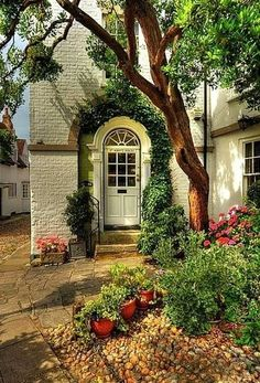 Love the old stone, vines around crescent door and floral