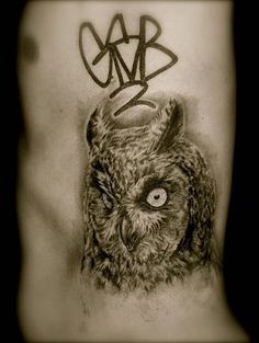 owl rib tattoo