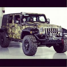 Camo jeep... if I'd have won the freaking powerball, i'd have bought this for C.