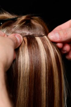 Extensions:  You can cover up dense grey tresses by sticking on some hair extensions right above the grey hair section. They not only bury those grey strands, but make your hair look denser.