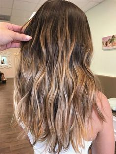 Extraordinary caramel balayage on brown hair