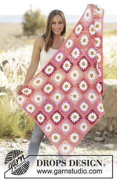 """Gehaakte DROPS deken met vierkantjes van """"Drops Paris"""". Maten: een vierkant meet 12 x 12 cm, deken meet ongeveer 79 x 118 cm."""