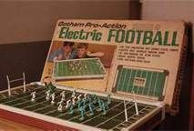 Electric Football.  My Uncle got one for Christmas and we all played it.  I remember it being very noisey.vintage toys from the 60's - Bing Images