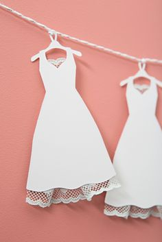 Using your Cricut Explore Air2, upload our free SVG cut file, choose 1 of 3 dress styles, embellish and use as the most darling bridal shower decor ever!
