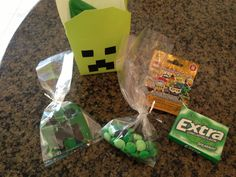 Minecraft Favor Boxes: Chinese takeout box decorated with Sharpie marker  Mint m mixed with black licorice Twizzler pieces Green gum Creeper cookie (made using Wilton fondant sheets and sugar cookies) LEGO mini figure (for fun!)