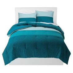 You'll be lulled to sleep in style with the Room Essentials Textured Colorblock Comforter Set. The mix of blues on this bed set will look great in your room. You can easily mix this set with your decor. Instantly make your room look put together with a great looking bedding set. Includes 2 shams and comforter.