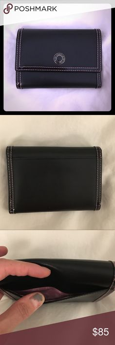 Black Leather Coach Wallet w/ Pink Leather Inside Black leather Coach wallet with pink leather inside and pink Coach logo inside. Minor discoloration inside from the black leather but otherwise the wallet is in excellent condition Coach Bags Wallets