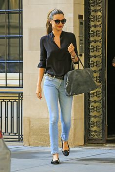Miranda Kerr leaves her apartment wearing denim jeans on the Upper East Side in New York City