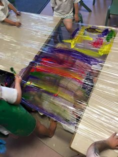 Image result for children painting saran wrap on table