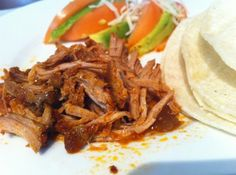 Spicy Chipotle Pulled Pork  #spicy #Yummy #mexican #crock-pot  This is a recipe my roommate taught me how to do... and then I spiced it up with some chipotle peppers!