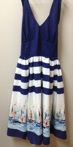 Halter dress in blue, white and sail boats made from Michael Miller's Regatta Border and Navy Cotton Couture fabrics for Trenna Travis Design Studio by Virginia Smith with Show Me Sewing