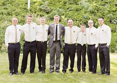 These groomsmen have a good thing going. mis matching ties all with the same tones coming though. It adds a casual feel to the day.