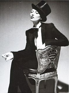 bohemea: Kate Moss: The Silent Beauty - Vanity Fair by Mert & Marcus, December 2006 The oversized hat & long bowtie tails are good touches, as well as the pensive, aloof expression. From androgyny.