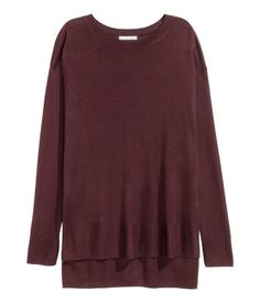 Plum. Long sweater in a soft, fine knit. Dropped shoulders, long sleeves, and slits at sides. Slightly longer at back.