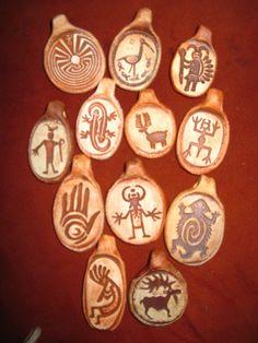 Collection of Twelve Rock Art petroglyph Design Pendants