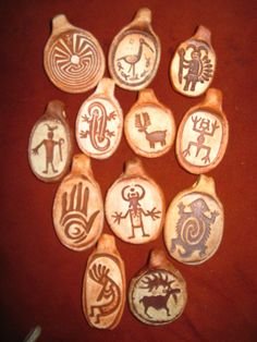 Collection of Twelve Rock Art petroglyph Design Pendants